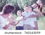 kids with young moms and dads... | Shutterstock . vector #760163059