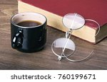 a cup of coffee with a book and ... | Shutterstock . vector #760199671