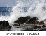 A White Crested Wave Crashes On ...