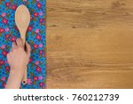 hand holding kitchen wood spoon.... | Shutterstock . vector #760212739