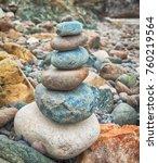 tower of stones on rocky beach | Shutterstock . vector #760219564