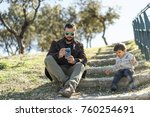 father and son in outdoors... | Shutterstock . vector #760254691