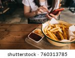 woman eating french fries while ... | Shutterstock . vector #760313785