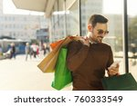 smiling young man carrying... | Shutterstock . vector #760333549