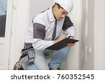 young builder writing something ... | Shutterstock . vector #760352545