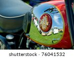 FARNBOROUGH, UNITED KINGDOM - APRIL 22: Classic British BSA motorcycle gas tank reflecting other vehicles at the annual Wheels Day auto show in Farnborough, UK on April 22, 2011. - stock photo