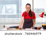 young woman in coveralls doing... | Shutterstock . vector #760446979