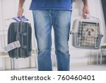 Stock photo little dog in the airline cargo pet carrier at the airport after a long journey 760460401