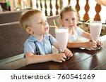 little boy and girl drinking... | Shutterstock . vector #760541269