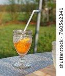 orange drink in the garden | Shutterstock . vector #760562341