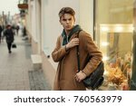 handsome young man with a... | Shutterstock . vector #760563979