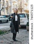fashionable young woman wearing ... | Shutterstock . vector #760571125
