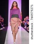 a model walks the runway on the ... | Shutterstock . vector #760575271