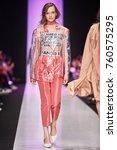 a model walks the runway on the ... | Shutterstock . vector #760575295