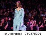 a model walks the runway on the ... | Shutterstock . vector #760575301