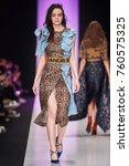 a model walks the runway on the ... | Shutterstock . vector #760575325