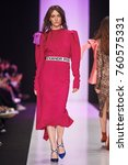 a model walks the runway on the ... | Shutterstock . vector #760575331