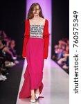 a model walks the runway on the ... | Shutterstock . vector #760575349