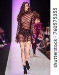 a model walks the runway on the ... | Shutterstock . vector #760575355