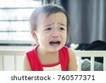 young girl toddler showing her... | Shutterstock . vector #760577371