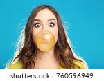 beautiful young girl blowing... | Shutterstock . vector #760596949
