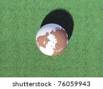 planet earth on green grass - stock photo