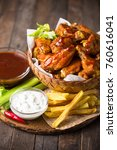 chicken wings with dips on the... | Shutterstock . vector #760616041