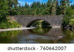 an arched bridge spans a slow... | Shutterstock . vector #760662007