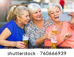 smiling senior women having a... | Shutterstock . vector #760666939