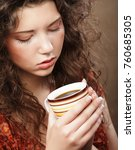 beautiful girl drinking tea or... | Shutterstock . vector #760685305