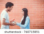 asian couple young man giving... | Shutterstock . vector #760715851
