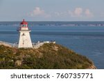 Small photo of ALBERT COUNTY, NB, CANADA - AUGUST 04, 2017: View of Cape Enrage lighthouse. Cape Enrage lighthouse is one of the oldest on New Brunswick's Fundy coastline.