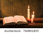 bible and candle on a old oak...