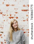 grinning blond girl in grey... | Shutterstock . vector #760860775