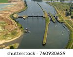 Small photo of Aerial view of sluice Prinses Maxima in river Maas near the town of Lith, Holland.