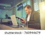 businessman office sitting on... | Shutterstock . vector #760944679
