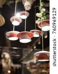 cups of lamps hang on the wire | Shutterstock . vector #760969129