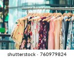 fashion cloth of women on rack | Shutterstock . vector #760979824