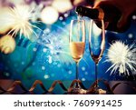 pouring champagne into glasses... | Shutterstock . vector #760991425