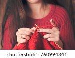 Woman Knits Sweater