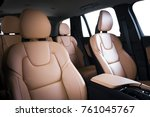 Luxury car inside. Interior of prestige modern car. Comfortable leather seats. Red perforarated leather cockpit with isolated white background. - stock photo
