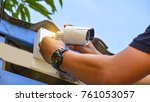Small photo of Technician installing wireless CCTV camera at house for security