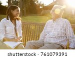 woman visiting senior male... | Shutterstock . vector #761079391
