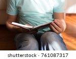 man reading old hardback book... | Shutterstock . vector #761087317