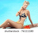 beautiful woman in bikini near... | Shutterstock . vector #76111180