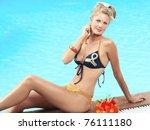 beautiful woman in bikini near... | Shutterstock . vector #76111180