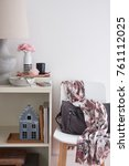 Small photo of Home entryway with a chair and a white sideboard. Basket and tray for storage and organisation. Contemporary scandinavian home decor.