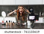 happy young girl recording her... | Shutterstock . vector #761133619