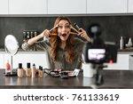 happy young girl recording her... | Shutterstock . vector #761133619