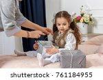 little girl sitting in a bed... | Shutterstock . vector #761184955